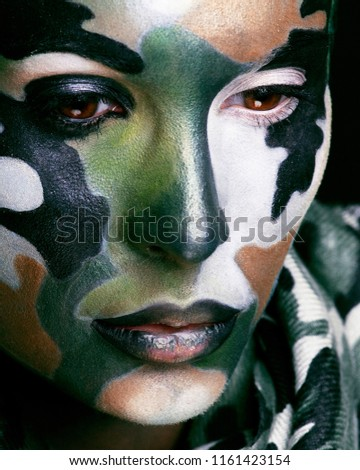 Army camouflage painted on angry soldier face Images and