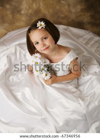young female child wearing her mother 39s wedding dress which is too big