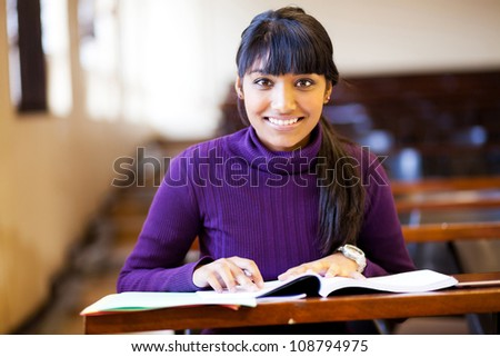 beautiful young female college student in classroom