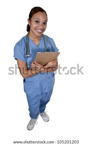 Beautiful young female doctor on her rounds - stock photo