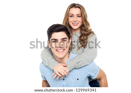 Beautiful young female enjoying piggy ride on her lovers back.