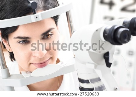 Beautiful young female patient is having a medical attendance at the optometrist.