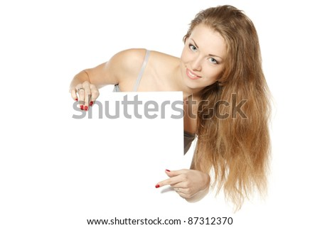 Beautiful young female pointing at blank copy-space over white background
