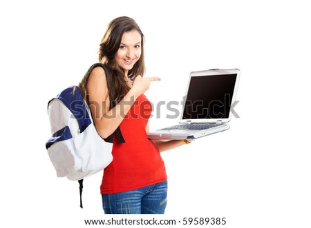 Beautiful young female student showing something on a laptop, isolated on white