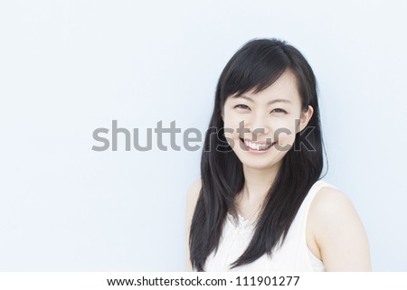 beautiful young girl against pale blue background