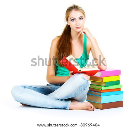 beautiful young girl and books isolated on white