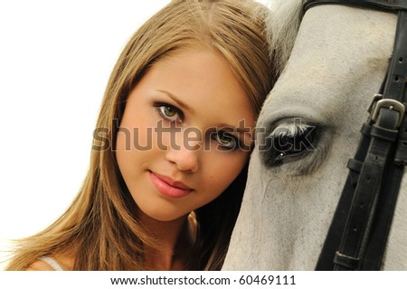 Beautiful young girl and white horse - stock photo