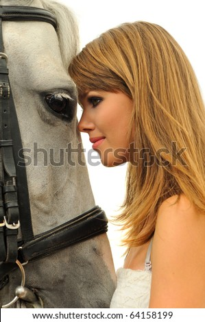 Beautiful young girl and white horse