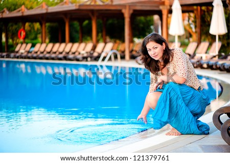 Beautiful young girl at the pool