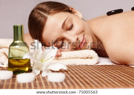 Beautiful young girl does spa treatments
