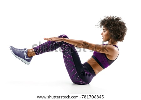 Stock Photo Beautiful young girl doing fitness exercise sit-ups, abs. Photo of african girl in silhouette on white background. Fitness and healthy lifestyle concept