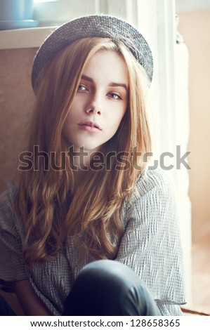 beautiful young girl dressed in a hipster style. vintage photo