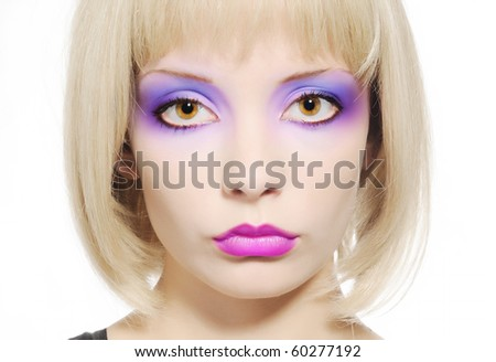 Beautiful young girl face with bright colored make-up