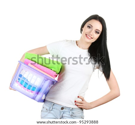 beautiful young girl holding basket of laundry isolated on white