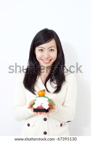 Beautiful Young Girl Holding Kagami Mochi, , Traditional ...