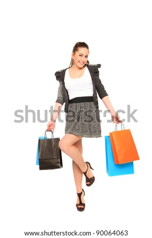 beautiful young girl holding shopping bags