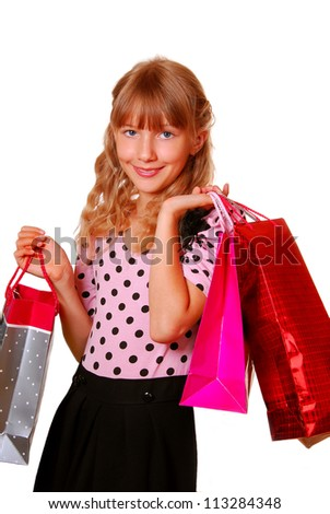 beautiful young girl holding the gift bags isolated on white