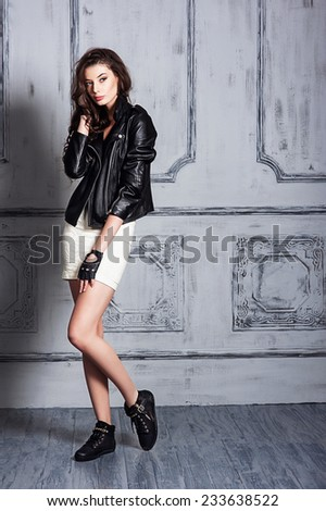 Beautiful young girl in a black blazer #233638522
