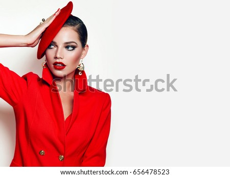 Beautiful young girl in a red jacket, jacket and red beret. Frenchwoman, style. Outerwear, headwear. Girl in retro style. Red lipstick. - Shutterstock ID 656478523