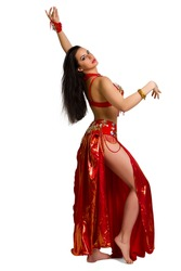 Beautiful young girl in a red suit oriental dance in motion isolated on white background