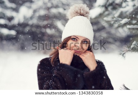 Beautiful Young Girl In A Winter Knitted Hat With A Pompon Closeup Portrait Of A