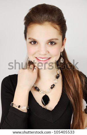 Beautiful young girl in an agate adornment