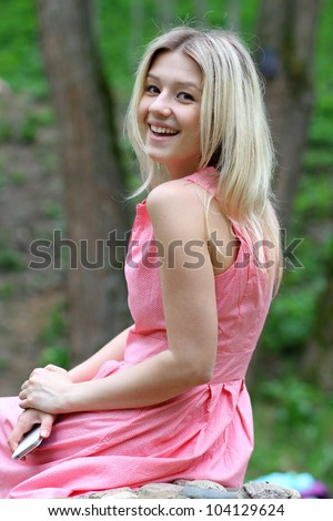 Beautiful young girl in pink dress