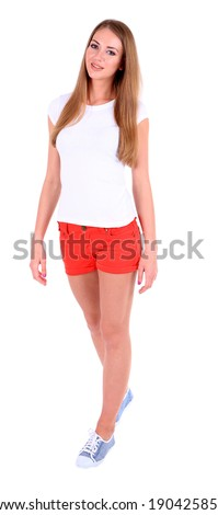 Stock Photo Beautiful young girl in shorts and t-shirt isolated on white