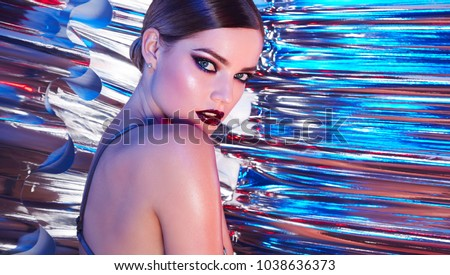 Beautiful young girl in the studio on a multicolored rainbow background - blue, blue, green, pink.  #1038636373