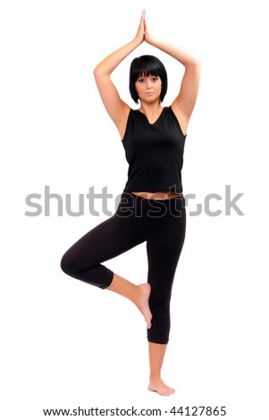 beautiful young girl in yoga pose tree pose vrikshasana