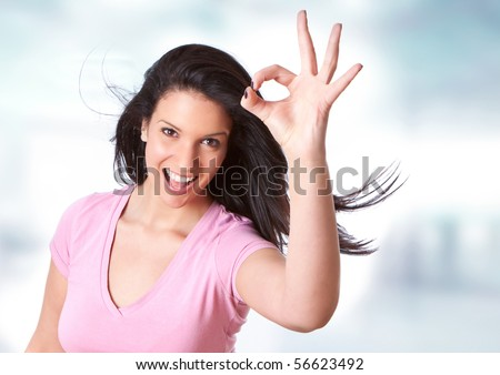 beautiful young girl making a zero sign