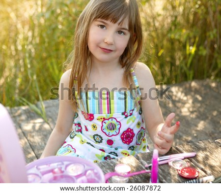 beautiful young girl portrait with make up set outdoors, at the park