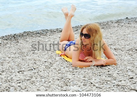 beautiful young girl posing at the summer beach