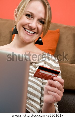Beautiful young girl shopping online, e-commerce concept