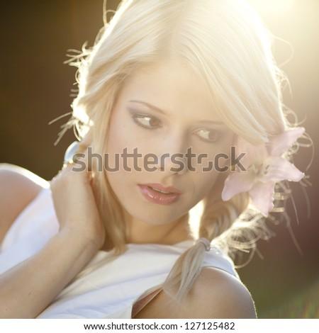 Beautiful young girl, shot against setting sun