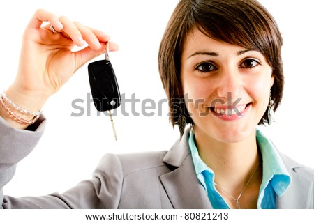 Beautiful young girl showing a key. Focus on hand. Isolated on white.