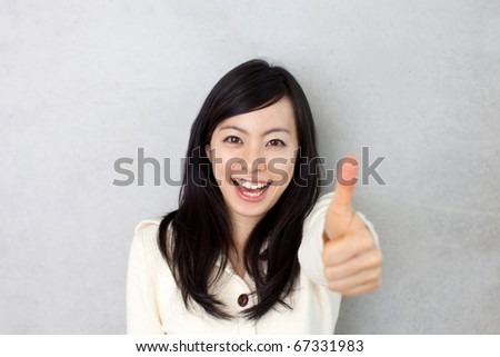 beautiful young girl showing thumb up