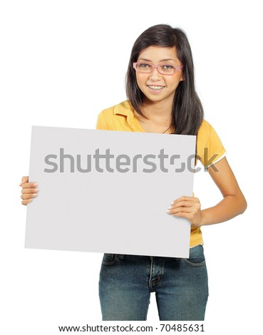 Beautiful young girl smiling holding big blank card