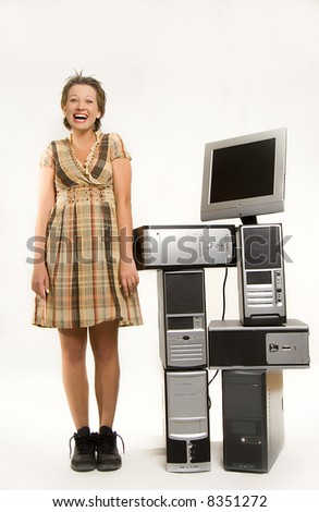 Beautiful young girl standing next to bunch of computers