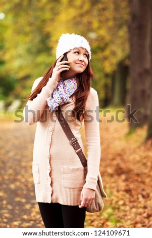 Beautiful young girl talking on cell phone. Beautiful Caucasian Teenager. Attractive young girl.