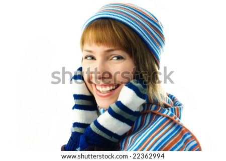 beautiful young girl wearing a scarf, hat and mittens isolated against white background