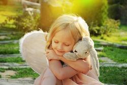 Beautiful young girl wearing angel wings