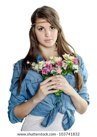Beautiful young girl with a bouquet of flowers.