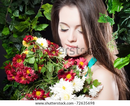 beautiful young girl with a bouquet of flowers #72635698