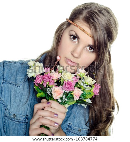 Beautiful young girl with a bouquet of flowers. studio