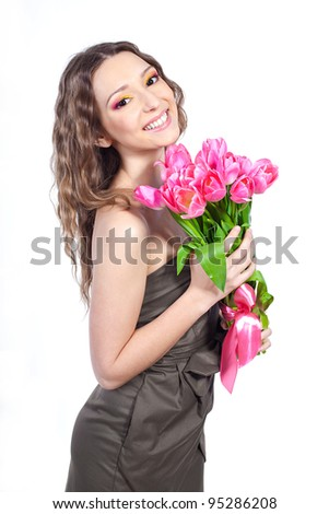Beautiful young girl with a bouquet of flowers. studio photography. Isolated.
