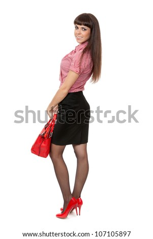 Beautiful young girl with a fashionable red handbag. Isolate on white.