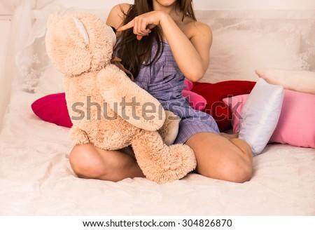 beautiful young girl with big teddy bear