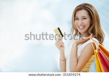 Beautiful young girl with credit card