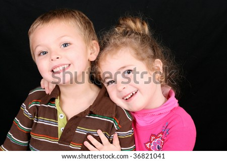 Beautiful young girl with curly hair and her cute boy friend - stock